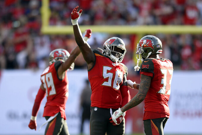 Tampa Bay Buccaneers linebacker Shaquil Barrett (58) celebrates with cornerback Carlton Davis (33) at Barrett sacked Atlanta Falcons quarterback Matt Ryan during the second half of an NFL football game Sunday, Dec. 29, 2019, in Tampa, Fla. (AP Photo/Jason Behnken)