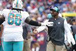 Miami Dolphins head coach Brian Flores, right, congratulates offensive guard Solomon Kindley (66) during the first half of an NFL football game against the New England Patriots, Sunday, Sept. 12, 2021, in Foxborough, Mass. (AP Photo/Steven Senne)