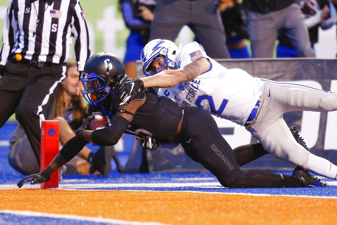Boise State wide receiver CT Thomas (6) dives in to the end zone for a touchdown as Air Force defensive back Jeremy Fejedelem (2) tries to bring him down in the first half of an NCAA college football game, Friday, Sept. 20, 2019, in Boise, Idaho. (AP Photo/Steve Conner)