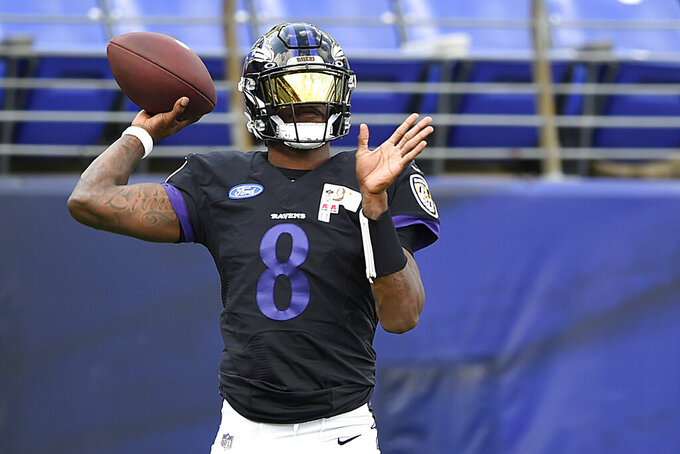 Baltimore Ravens quarterback Lamar Jackson throws a pass during NFL football training camp Saturday, Aug. 29, 2020, in Baltimore. (AP Photo/Gail Burton)