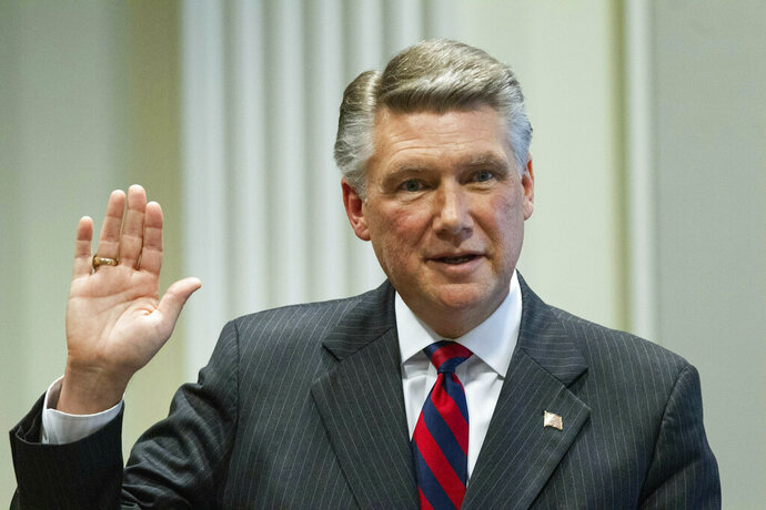 Mark Harris, Republican candidate in North Carolina's 9th Congressional race, prepares to testify during the fourth day of a public evidentiary hearing on the 9th Congressional District voting irregularities investigation Thursday, Feb. 21, 2019, at the North Carolina State Bar in Raleigh, N.C.  (Travis Long/The News & Observer via AP, Pool)