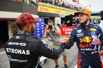 Red Bull driver Max Verstappen of the Netherlands, right, shakes hands with Mercedes driver Lewis Hamilton of Britain after he clocked the fastest time during the qualifying session ahead of the French Formula One Grand Prix at the Paul Ricard racetrack in Le Castellet, southern France, Saturday, June 19, 2021. The French Grand Prix will be held on Sunday. (Nicolas Tucat/Pool via AP)