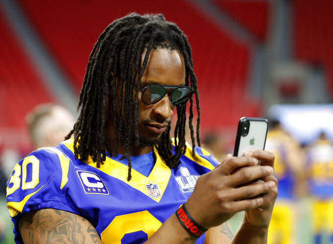 Los Angeles Rams running back Todd Gurley (30) photographs a teammate during walkthrough at the Mercedes Benz Stadium for the NFL Super Bowl 53 football game against the New England Patriots, Saturday, Feb. 2, 2019, in Atlanta. (AP Photo/John Bazemore)