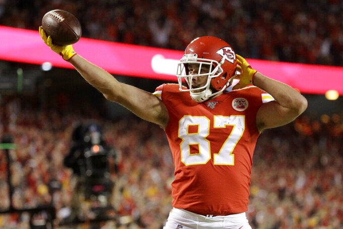 Kansas City Chiefs tight end Travis Kelce (87) celebrates a touchdown during the first half of an NFL football game against the Green Bay Packers in Kansas City, Mo., Sunday, Oct. 27, 2019. (AP Photo/Charlie Riedel)