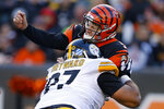 Pittsburgh Steelers defensive end Cameron Heyward (97) hits Cincinnati Bengals quarterback Ryan Finley (5) after the pass during the second half an NFL football game, Sunday, Nov. 24, 2019, in Cincinnati. (AP Photo/Gary Landers)