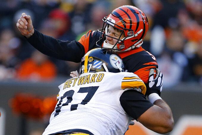 Pittsburgh Steelers defensive end Cameron Heyward (97) hits Cincinnati Bengals quarterback Ryan Finley (5) after the pass during the second half an NFL football game, Sunday, Nov. 24, 2019, in Cincinnati. (AP Photo/Gary Landers)
