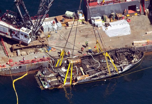 FILE - In this Sept. 12, 2019, file photo, the burned hull of the dive boat Conception is brought to the surface by a salvage team off Santa Cruz Island, Calif. Sen. Dianne Feinstein proposed a bill Thursday, Dec. 12, 2019, to tighten safety standards for small boats in the aftermath of the burning and sinking of the diving charter vessel that killed 34 people. (Brian van der Brug/Los Angeles Times via AP, File)