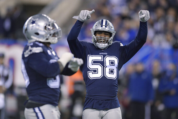 Dallas Cowboys defensive end Robert Quinn (58) reacts after a play against the New York Giants during the first quarter of an NFL football game, Monday, Nov. 4, 2019, in East Rutherford, N.J. (AP Photo/Bill Kostroun)