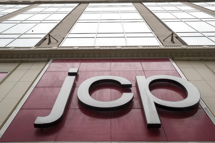 In this Wednesday, May 16, 2018, photo, the JC Penney logo is seen hanging outside the Manhattan mall in New York.  J.C. Penney Co. reports earnings on Thursday, May 17. (AP Photo/Mary Altaffer)
