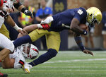 Notre Dame quarterback Brandon Wimbush, right, is sacked by Ball State defensive tackle Chris Crumb during the second half of an NCAA college football game in South Bend, Ind., Saturday, Sept. 8, 2018. Notre Dame won 24-16. (AP Photo/Nam Y. Huh)