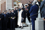 "FILE - In this March 21, 2018, file photo, Gayle Benson, widow of NFL New Orleans Saints and NBA New Orleans Pelicans owner Tom Benson, walks down the steps to receive his casket with New Orleans Archbishop Gregory Aymond for visitation at Notre Dame Seminary in New Orleans. Attorneys for several men suing the Roman Catholic church say documents they obtained through discovery show that the New Orleans Saints team aided the Archdiocese of New Orleans in its ""pattern and practice of concealing its crimes."" (AP Photo/Gerald Herbert, File)"