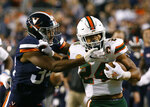 Miami running back Travis Homer (24) pushes off Virginia cornerback Bryce Hall (34) during the first half of an NCAA college football game in Charlottesville, Va., Saturday, Oct. 13, 2018. (AP Photo/Steve Helber)