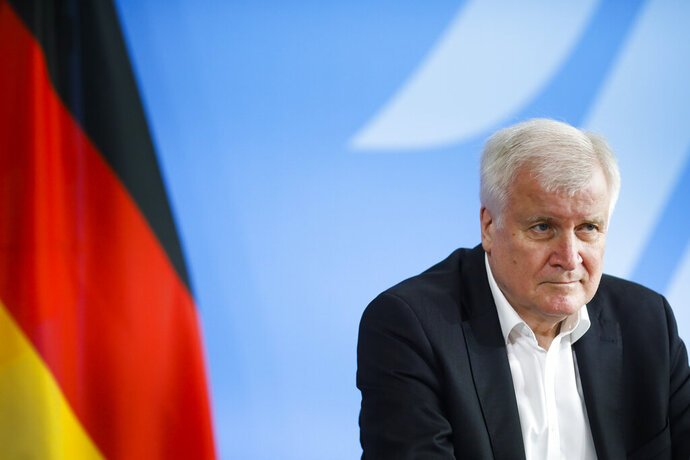German Interior Minister Horst Seehofer briefs the media after a meeting with his Austrian counterpart Karl Nehammer at the Interior Ministry in Berlin, Germany, Wednesday, June 24, 2020. (AP Photo/Markus Schreiber, Pool)