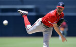 Washington Nationals starting pitcher Stephen Strasburg works against a San Diego Padres batter during the first inning of a baseball game, Sunday, June 9, 2019, in San Diego. (AP Photo/Orlando Ramirez)