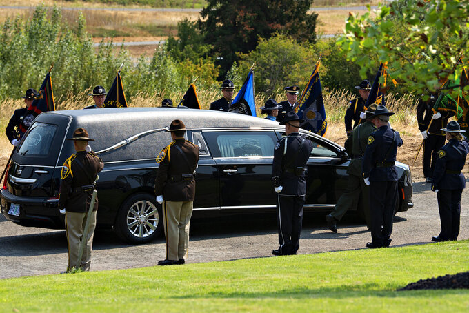 The remains of Clark County Sheriff's Detective Jeremy Brown, who was shot to death July 23 while on duty, arrive at ilani Casino as a multi-agency honor guard pays tribute in La Center, Wash., Tuesday, Aug. 3, 2021. Hundreds of law enforcement and first responder vehicles lined up earlier in the day for a procession to honor Brown, 46, who was promoted to honorary sergeant after his death. (Amanda Cowan/The Columbian via AP)
