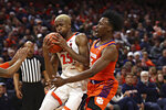 Virginia forward Mamadi Diakite (25) is defended by a Clemson player during an NCAA college basketball game Wednesday, Feb. 5, 2020, in Charlottesville, Va. (Erin Edgerton/The Daily Progress via AP)