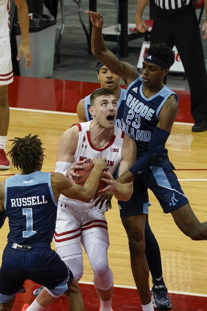 Rhode Island's Fatts Russell steals the ball from Wisconsin's Micah Potter during the second half of an NCAA college basketball game Wednesday, Dec. 9, 2020, in Madison, Wis. (AP Photo/Morry Gash)