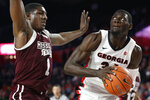Georgia forward Derek Ogbeide (34) looks for a shot while being defended by Mississippi State forward Reggie Perry (1) during an NCAA college basketball game in Athens, Ga., Wednesday, Feb. 20, 2019. (Joshua L. Jones/Athens Banner-Herald via AP)
