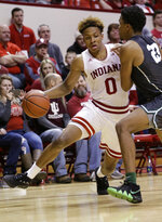 Indiana guard Romeo Langford (0) goes around Jacksonville guard Tyreese Davis (23) during the second half of an NCAA college basketball game in Bloomington, Ind., Saturday, Dec. 22, 2018. Indiana won 94-64. (AP Photo/AJ Mast)