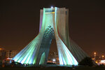 FILE— In this March 29, 2014 file photo, the Azadi (Freedom) tower is illuminated in the Iranian capital, Tehran. Iran's ancient and rich cultural landscape has become a potential U.S. military target as Washington and Tehran stumble toward a possible open conflict. (AP Photo/Ebrahim Noroozi, File)