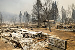 A church marquee stands among buildings destroyed by the Dixie Fire in Greenville on Thursday, Aug. 5, 2021, in Plumas County, Calif. (AP Photo/Noah Berger)