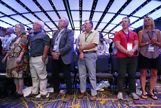 Audience members listen to South Dakota Gov. Kristi Noem speak during the Family Leadership Summit, Friday, July 16, 2021, in Des Moines, Iowa. (AP Photo/Charlie Neibergall)