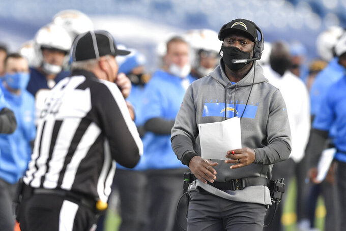 Los Angeles Chargers head coach Anthony Lynn, right, works the sideline during the second half of an NFL football game against the Buffalo Bills, Sunday, Nov. 29, 2020, in Orchard Park, N.Y. (AP Photo/Adrian Kraus)