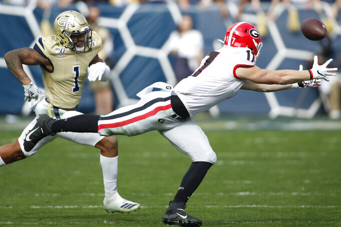 Georgia tight end Eli Wolf (17) reaches for a pass against Georgia Tech during the first half of an NCAA college football game Saturday, Nov. 30, 2019, in Atlanta. (Joshua L. Jones/Athens Banner-Herald via AP)