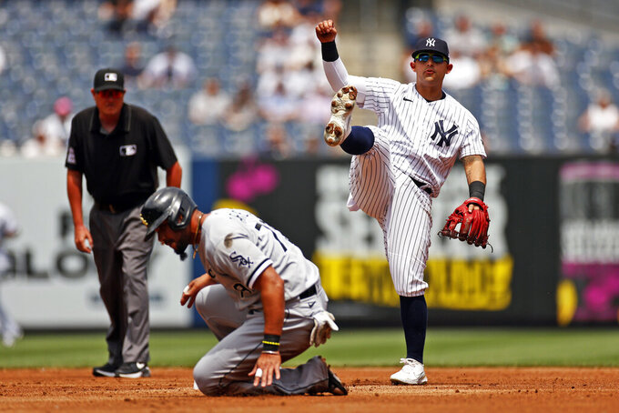 New York Yankees second baseman Rougned Odor reacts after turning a double play over Chicago White Sox's Jose Abreu during the second inning of a baseball game on Saturday, May 22, 2021, in New York. (AP Photo/Adam Hunger)