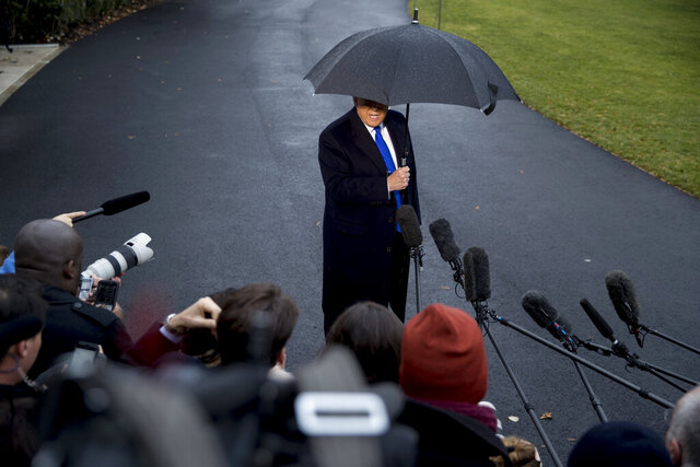President Donald Trump speaks to members of the media before boarding Marine One on the south Lawn of the White House in Washington, Monday, Dec. 2, 2019, for a short trip to Andrews Air Force Base, Md., and then on to London. (AP Photo/Andrew Harnik)