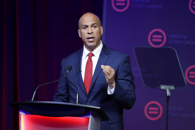 FILE - Then-Democratic presidential candidate Corey booker speaks during the National Urban League Conference  in Indianapolis, in this Thursday, July 25, 2019, file photo. A bill being introduced Thursday, Dec. 17, 2020, by four Democratic lawmakers would grant college athletes sweeping rights to compensation, including a share of the revenue generated by their sports, and create a federal commission on college athletics. The College Athletes Bill of Rights is sponsored by U.S. Senators Corey Booker (D-N.J.), Richard Blumenthal (D-Conn.) and Kirsten Gillibrand (D-N.Y.), and U.S. Rep. Jan Schakowsky (D-Ill.). If passed it could wreak havoc with the NCAA's ability to govern intercollegiate athletics, and the association's model for amateurism.(AP Photo/Darron Cummings, File)