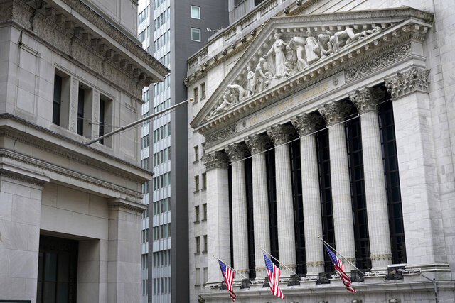 The New York Stock Exchange is seen in New York, Monday, Nov. 23, 2020.  U.S. stocks are ticking higher and heading back toward record highs on Friday, Dec. 4, despite discouraging data detailing how much damage the deepening pandemic is doing to the job market.  (AP Photo/Seth Wenig)