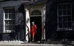 British Prime Minister Theresa May walks walks out to make a speech outside 10 Downing Street in London, England, Friday, May 24, 2019. May says she'll quit as UK Conservative leader on June 7, sparking contest for Britain's next prime minister. (AP Photo/Alastair Grant)