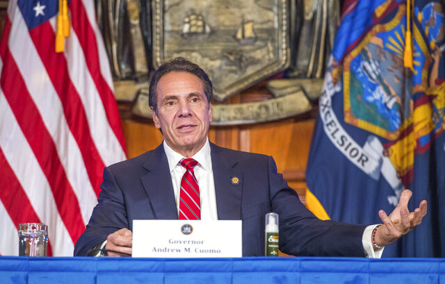 In this Wednesday, Nov. 18, 2020 photo provided by the Office of Governor Andrew M. Cuomo, Gov. Cuomo holds a press briefing on the coronavirus in the Red Room at the State Capitol in Albany, N.Y. During the news conference, Cuomo predicted a