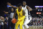 Marquette's Sacar Anim (2) is defended by Providence's Alpha Diallo, right, during the first half of an NCAA college basketball game Saturday, Feb. 22, 2020, in Providence, R.I. (AP Photo/Stew Milne)