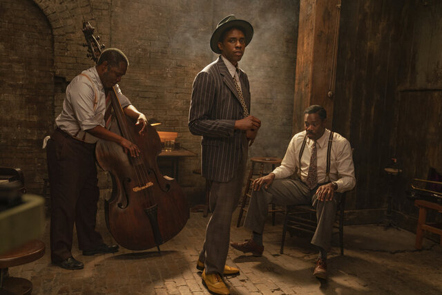 This image released by Netflix shows Michael Potts, from left, Chadwick Boseman and Colman Domingo in