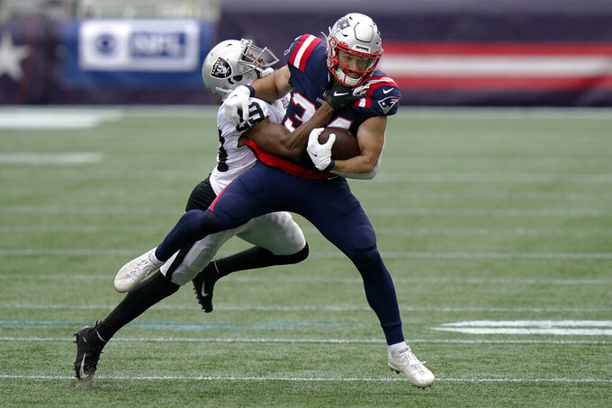 Las Vegas Raiders safety Lamarcus Joyner, left, tackles New England Patriots running back Rex Burkhead in the first half of an NFL football game, Sunday, Sept. 27, 2020, in Foxborough, Mass. (AP Photo/Steven Senne)