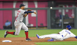 Boston Red Sox shortstop Xander Bogaerts, left, throws over a sliding Kansas City Royals' Jarrod Dyson for a double play against Royals batter Adalberto Mondesi during the seventh inning of a baseball game in Kansas City, Mo., Friday, June 18, 2021. (AP Photo/Reed Hoffmann)