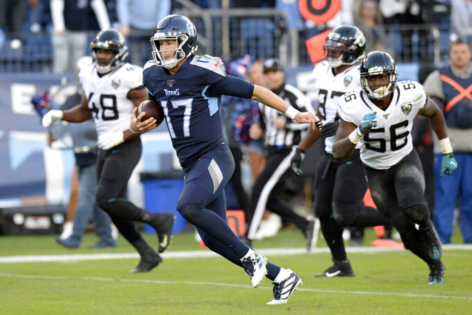 Tennessee Titans quarterback Ryan Tannehill (17) runs 21 yards for a touchdown against the Jacksonville Jaguars in the first half of an NFL football game Sunday, Nov. 24, 2019, in Nashville, Tenn. (AP Photo/Mark Zaleski)