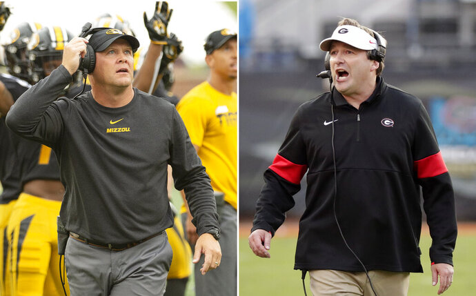 FILE - At left, in a Sept. 21, 2019, file photo, Missouri head coach Barry Odom watches a replay on the scoreboard during the first quarter of an NCAA college football game against South Carolina, in Columbia, Mo. At right, in a Nov. 2, 2019, file photo, Georgia head coach Kirby Smart directs his team against Florida during the second half of an NCAA college football game, in Jacksonville, Fla. When Southeastern Conference coaches gather and Georgia's Kirby Smart wants to talk defense, he looks for Missouri's Barry Odom. Both were defensive coordinators before being hired to take over programs at their alma maters. One more similarity: Smart and Odom bring the SEC's top defenses into Saturday night's important Eastern Division game. (AP Photo/File)