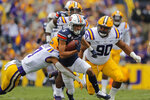 Auburn wide receiver Anthony Schwartz (5) carries against LSU safety Grant Delpit (7) in the first half of an NCAA college football game in Baton Rouge, La., Saturday, Oct. 26, 2019. (AP Photo/Gerald Herbert)