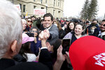 U.S. Rep. Matt Gaetz, R-Fla., grabs the hand of a supporter following a rally against U.S. Rep. Liz Cheney, R-Wyo., Thursday, Jan. 28, 2021, outside the Wyoming State Capitol in Cheyenne. Gaetz spoke to hundreds, bashing Rep. Cheney after she voted to impeach former President Donald Trump for his role in the Jan. 6 insurrection at the U.S. Capitol, and called for a group effort in finding the right nominee to replace her when she is up for reelection in 2022. (Michael Cummo/The Wyoming Tribune Eagle via AP)