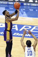 LSU's Ja'Vonte Smart, left, shoots near Kentucky's Davion Mintz (10) during the first half of an NCAA college basketball game in Lexington, Ky., Saturday, Jan. 23, 2021. (AP Photo/James Crisp)