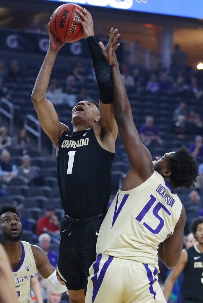 Colorado's Tyler Bey shoots over Washington's Noah Dickerson during the first half of an NCAA college basketball game in the semifinals of the Pac-12 men's tournament Friday, March 15, 2019, in Las Vegas. (AP Photo/John Locher)