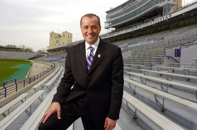 Jim Phillips poses at Ryan Field at Northwestern after being named the schools Athletic Director in Evanston, Ill., in this April 22, 2008, photo. The Atlantic Coast Conference is finalizing an deal to make Northwestern athletic director Jim Phillips the league's next commissioner. Two people with knowledge of the situation told The Associated Press they expected an agreement to be reached with Phillips and the conference soon.  (Al Podgorski/Chicago Sun-Times via AP)