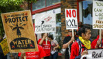 FILE - In this June 12, 2019, file photo, protesters walk up Main Street inasa procession protesting against the Keystone XL pipeline makes its way to Andrew W. Bogue Federal Courthouse in Rapid City, S.D. A U.S. Supreme Court decision this week could further stall construction of the disputed pipeline just as work began this spring after years of delay. (Adam Fondren/Rapid City Journal via AP, File)
