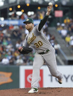 Oakland Athletics pitcher Brett Anderson throws to a San Francisco Giants batter during the first inning of a baseball game in San Francisco, Tuesday, Aug. 13, 2019. (AP Photo/Jeff Chiu)