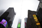 A high-wire crosses Times Square, Thursday, June 20, 2019 in New York. Performers Nik and Lijana Wallenda will cross Times Square on the high wire on Sunday. (AP Photo/Mark Lennihan)