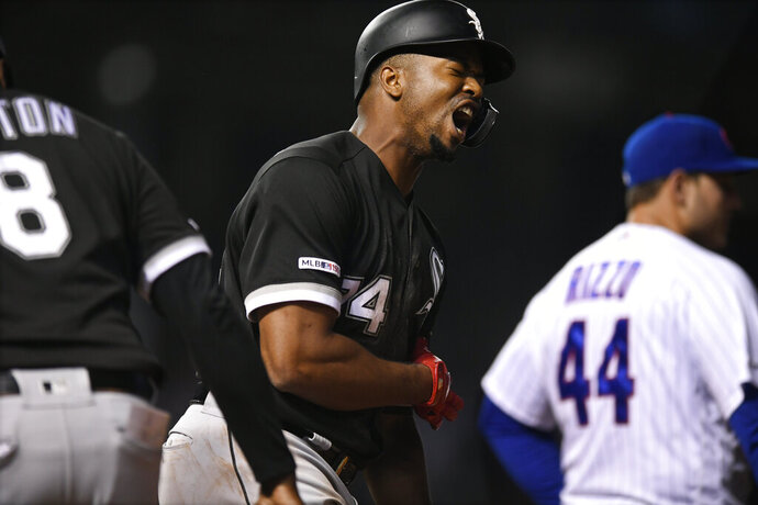 Chicago White Sox's Eloy Jimenez (74) celebrates after hitting a two-run home run during the ninth inning of a baseball game against the Chicago Cubs Tuesday, June 18, 2019, at Wrigley Field in Chicago. (AP Photo/Paul Beaty)