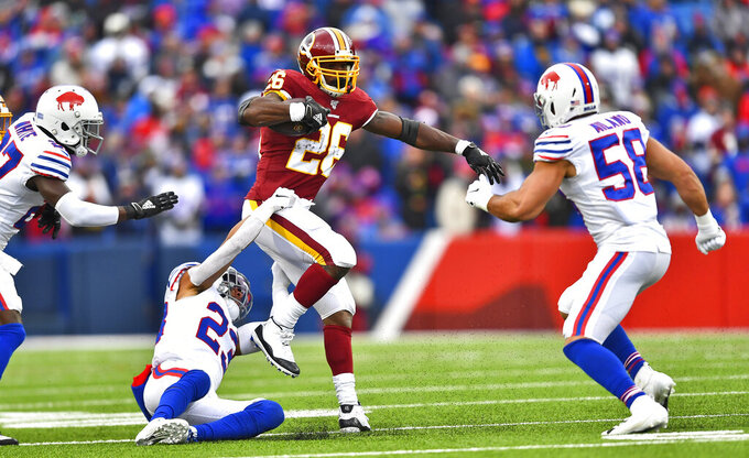 Washington Redskins running back Adrian Peterson (26) rushes for a first down against the Buffalo Bills during the first half of an NFL football game, Sunday, Nov. 3, 2019, in Orchard Park, N.Y. (AP Photo/Adrian Kraus)